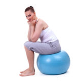 Woman sitting on the big blue ball Stock Photo