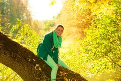 Woman sitting on big tree trunk Royalty Free Stock Photography