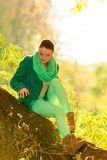 Woman sitting on big tree trunk Royalty Free Stock Images