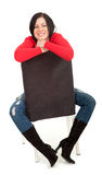 Woman sitting on the black chair Royalty Free Stock Images
