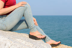 Woman sitting with blue sky and sea Royalty Free Stock Photo