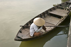 Woman sitting in boat, Hoi An, Vietnam Royalty Free Stock Photography