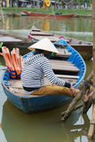Woman sitting in boat, Hoi An, Vietnam Stock Photography