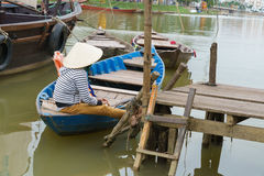 Woman sitting in boat, Hoi An, Vietnam Stock Photos