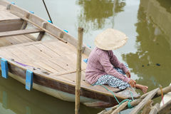 Woman sitting in boat, Hoi An, Vietnam Royalty Free Stock Photos