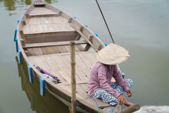 Woman sitting in boat, Hoi An, Vietnam Royalty Free Stock Image