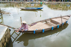 Woman sitting in boat, Hoi An, Vietnam Royalty Free Stock Images
