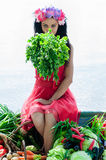 Woman sitting on the boat with parsley Royalty Free Stock Images