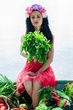Woman sitting on the boat with parsley in hand Stock Photography