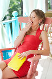 Woman sitting with book and yawing Royalty Free Stock Photos