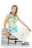 Woman sitting on books Royalty Free Stock Photography