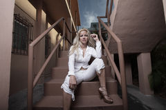 Woman sitting on a building staircase Royalty Free Stock Photos