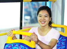 Woman sitting by bus Stock Photos