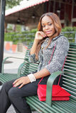 Woman sitting on a bus bench Royalty Free Stock Image