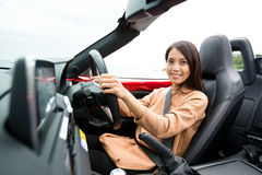 Woman sitting in cabriolet Royalty Free Stock Photo