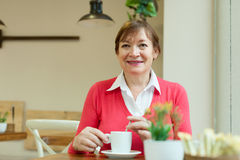 Woman sitting in   cafe Royalty Free Stock Photography