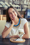 Woman sitting in cafe with cappuccino Royalty Free Stock Photography