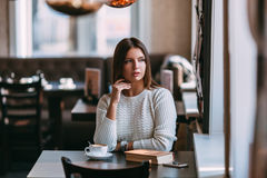 Woman sitting in the cafe with a cup of coffee Royalty Free Stock Photo