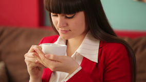 Woman sitting at cafe with cup of coffee stock video