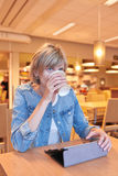 Woman sitting in the cafe Royalty Free Stock Photo