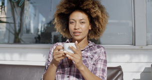 Woman Sitting At A Cafe And Drinks A Coffee Royalty Free Stock Photo