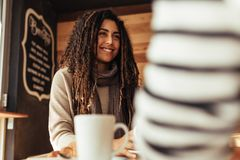 Woman sitting in a cafe with her friend royalty free stock image