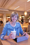 Woman sitting in the cafe Stock Images