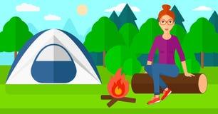 Woman sitting at camp. Stock Photo