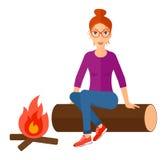Woman sitting at camp Stock Image