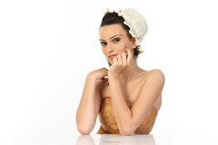Woman sitting with the cap Royalty Free Stock Images