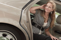 Woman sitting in a car Royalty Free Stock Photography