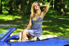 Woman sitting in a car Stock Photography