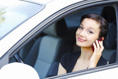 Woman sitting in a car Royalty Free Stock Images