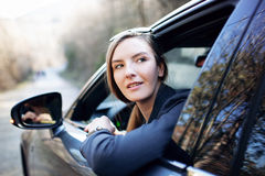 Woman sitting in car Stock Images