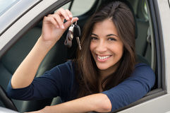 Woman Sitting In Car With Key. Young Happy Woman Showing The Key Of New Car Royalty Free Stock Image