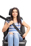 Woman sitting on car seat fastened with a seatbelt Stock Images