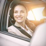 Woman sitting in a car and smiling Royalty Free Stock Photo