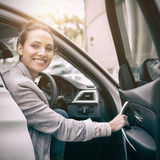 Woman sitting in a car and smiling at camera Stock Photo