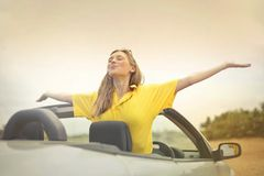 Woman Sitting on Car Under Gray Sky royalty free stock photography