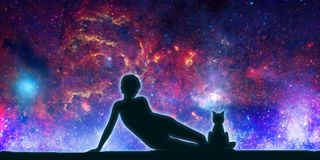 Silhouettes of woman and cat. The woman sitting with cat. Elements of this image furnished by NASA. Deep space filled with stars, nebula and galaxy. Cutout Royalty Free Stock Images