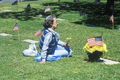 Woman Sitting in Cemetery Royalty Free Stock Photo