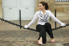 Woman sitting on chain Stock Images
