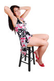 Woman sitting on chair. Lovely young woman in high heels sitting on a chair in the studio with long Royalty Free Stock Photos