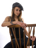 Woman sitting on a chair Stock Photography