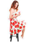 Woman sitting on chair. Royalty Free Stock Photos