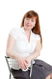 Woman sitting in a chair Stock Photos