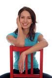 Woman sitting on chair Royalty Free Stock Images
