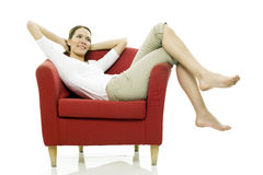 Woman sitting on a chair Stock Photo