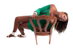Woman sitting on a chair Stock Photos