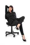 Woman sitting on a chair Stock Images